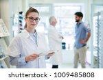beautiful optician is standing... | Shutterstock . vector #1009485808