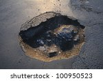 Big Pothole Photo Of A...
