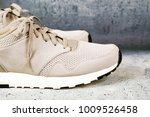 pair of men's sports shoes on a ... | Shutterstock . vector #1009526458