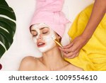 young woman in the spa make a... | Shutterstock . vector #1009554610