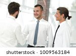 employees greet each other by... | Shutterstock . vector #1009563184