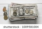 stack of dollar bills and coins ... | Shutterstock . vector #1009581004