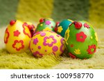 Coloured eggs for easter on green background - stock photo