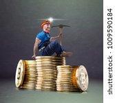 miner man posing with a golden... | Shutterstock . vector #1009590184