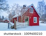 Winter Scenery With Red Wooden...