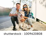 Stock photo young stylish couple posing with dog in street man and woman happy family together husky breed 1009620808