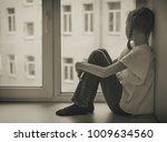 sad little girl sitting near...   Shutterstock . vector #1009634560