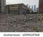 demolish building with debris... | Shutterstock . vector #1009635568