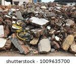 demolish building with debris... | Shutterstock . vector #1009635700