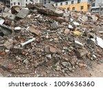 demolish building with debris... | Shutterstock . vector #1009636360