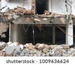 demolish building with debris... | Shutterstock . vector #1009636624