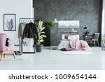 clothes on a rack in...   Shutterstock . vector #1009654144