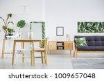 poster above rustic cupboard... | Shutterstock . vector #1009657048