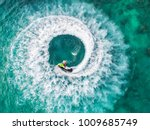 people are playing a jet ski in ... | Shutterstock . vector #1009685749