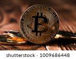 golden bitcoin on money bills... | Shutterstock . vector #1009686448