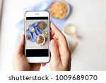 young woman food blogger takes... | Shutterstock . vector #1009689070