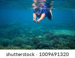 Woman Swimming In Blue Water