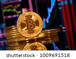 gold coin bitcoin stacked on a... | Shutterstock . vector #1009691518