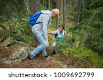 active senior couple hiking on... | Shutterstock . vector #1009692799