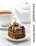 cake on background of cup with... | Shutterstock . vector #1009694434