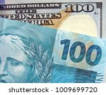 Small photo of Hundred dollars and hundred reais with new notes brazilian and eua currency