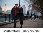 couple walking along south bank ... | Shutterstock . vector #1009707700