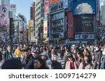 crowd crossing road at shibuya... | Shutterstock . vector #1009714279
