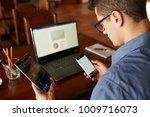 attractive man in glasses... | Shutterstock . vector #1009716073