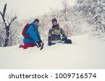 happy snowboarders are sitting... | Shutterstock . vector #1009716574