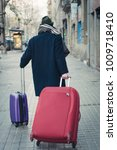 man with luggage on barcelona... | Shutterstock . vector #1009718410