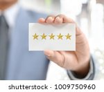businessman and star evaluation ... | Shutterstock . vector #1009750960