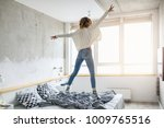 young happy woman jumping on... | Shutterstock . vector #1009765516