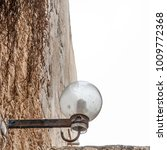 lamp on street of stone old...   Shutterstock . vector #1009772368