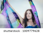 beautiful girl in the beach... | Shutterstock . vector #1009779628