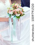 colorful bouquet in hand of... | Shutterstock . vector #1009791520