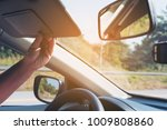 lady adjust sun visor while... | Shutterstock . vector #1009808860