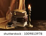 still life with books and candle | Shutterstock . vector #1009813978