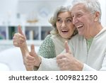happy senior couple at home | Shutterstock . vector #1009821250