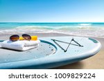 surfboard and summer time on... | Shutterstock . vector #1009829224