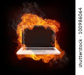 Laptop in Fire isolated on black Bacground. - stock photo