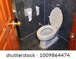 white toilet bowl top view    | Shutterstock . vector #1009864474