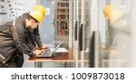 two maintenance engineers... | Shutterstock . vector #1009873018