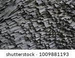 dark basalt column formation in ... | Shutterstock . vector #1009881193