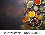 set of various spices on dark... | Shutterstock . vector #1009883830