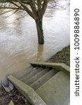Small photo of The stairs descending to the banks of the river Marne are flooded halfway up by the important rise in the water level.