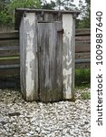 An Old Weathered Outhouse On...