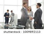 handshake business partners at... | Shutterstock . vector #1009892113
