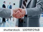 business people shaking hands. | Shutterstock . vector #1009892968