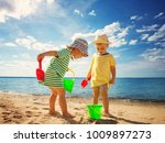 boy and girl playing on the... | Shutterstock . vector #1009897273
