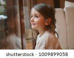 cheerful little girl waiting... | Shutterstock . vector #1009899058